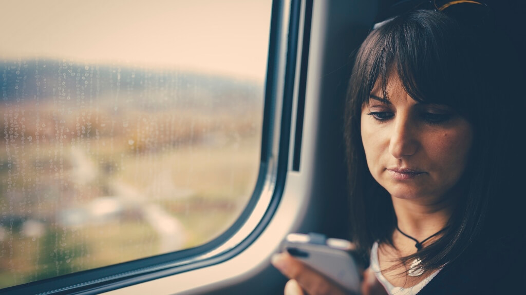 Woman using smartphone in train