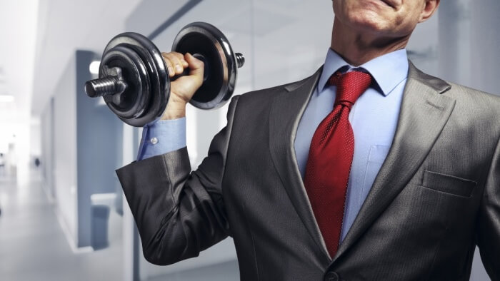 dumbbell-lifting business man
