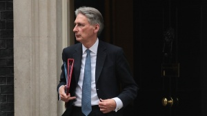 Hammond Won't Serve With Johnson, Delivers Brexit Warning