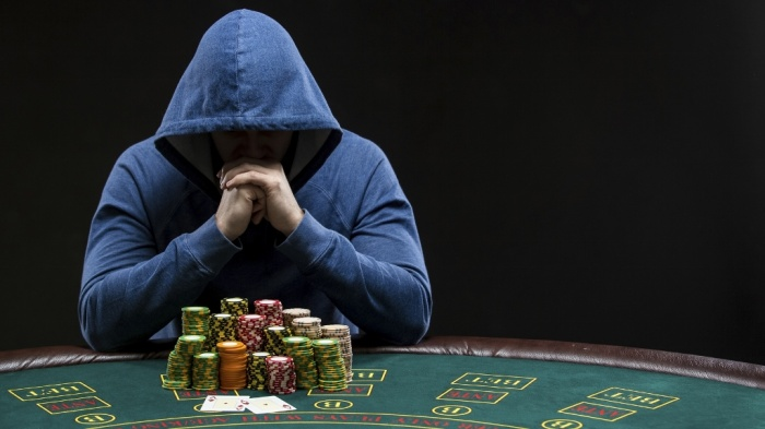 Poker player looking at combination of two aces. Closeup